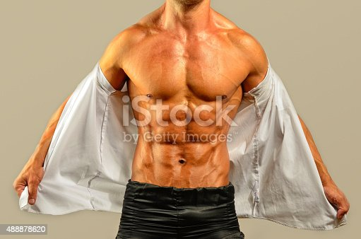 514857923istockphoto Close up on perfect abs, topless strong bodybuilder 488878620