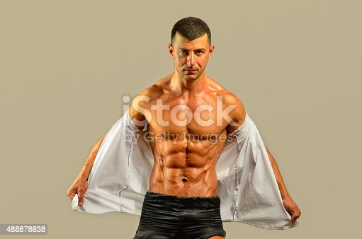 514857923istockphoto Close up on perfect abs, topless strong bodybuilder 488878638
