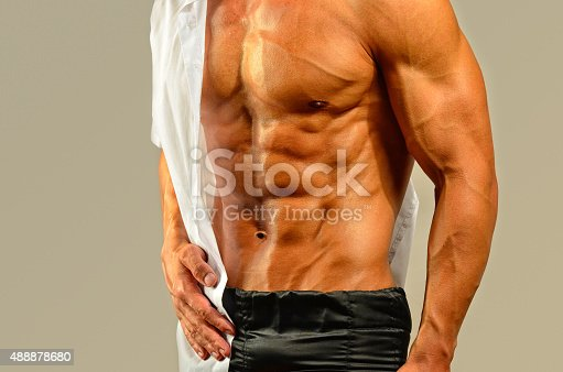 514857923istockphoto Close up on perfect abs, topless strong bodybuilder 488878680