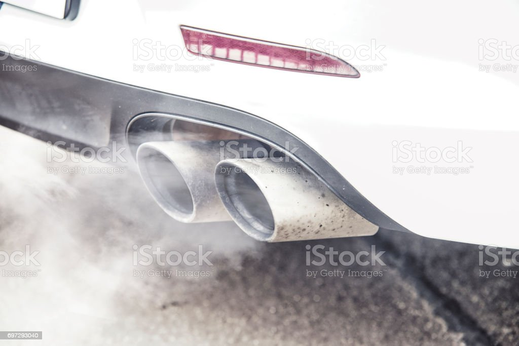 close up on pipe exhaust car smoke emission stock photo