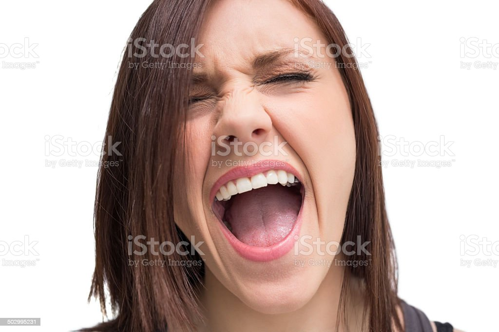 Close up on pretty brunette shouting stock photo