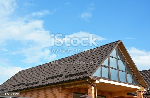 KYIV, UKRAINE - July 20, 2016: Close up on roof snow guards. Metal roof snow guards prevent the avalanche of frozen precipitation on sloped metal roofing located in winter climates.