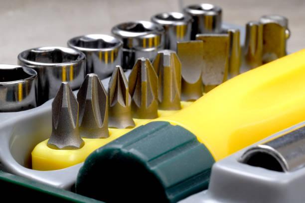 close up on screwdriver bit set in toolbox, macro stock photo