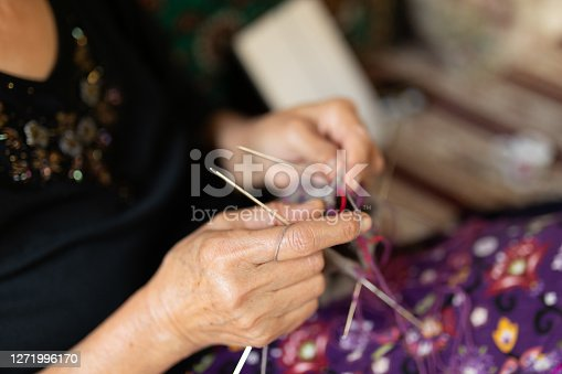 Close up on senior woman's hands knitting