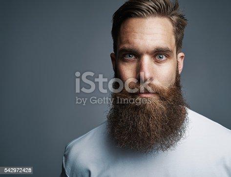 istock Close up on serious man with long beard 542972428