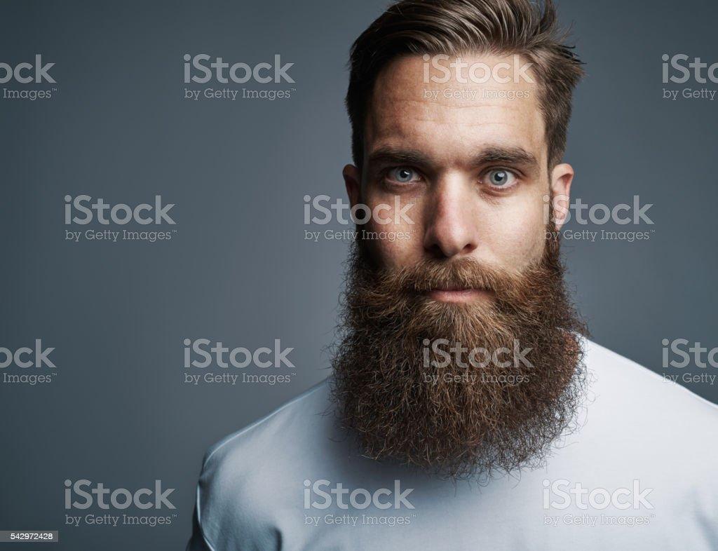 Close up on serious man with long beard stock photo