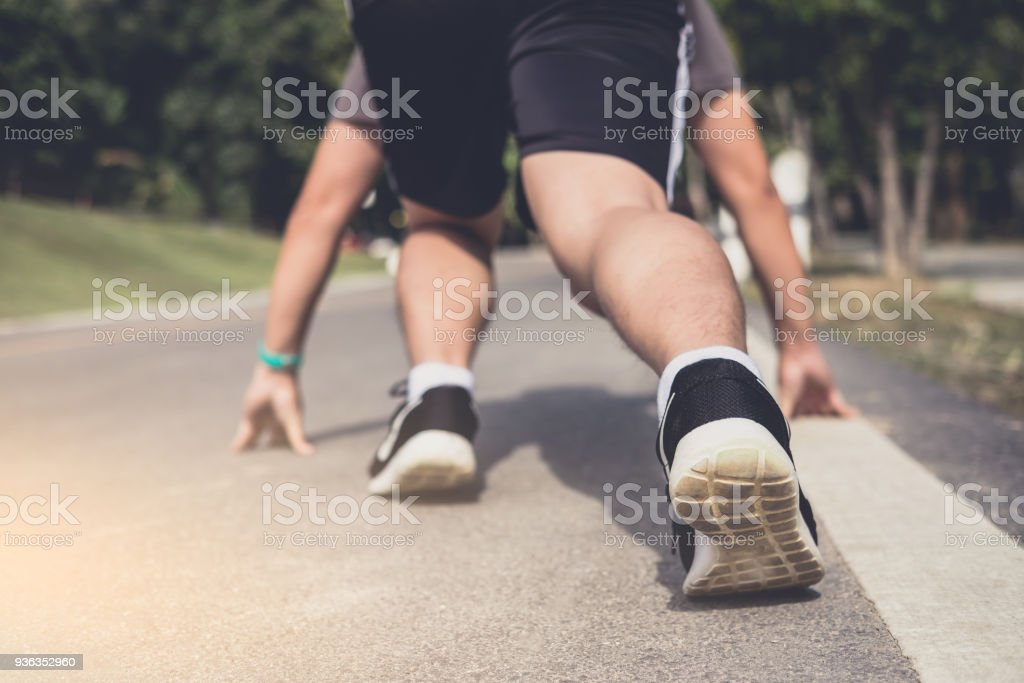 Close up on shoes, athlete runner feet running on track to begin starting stock photo