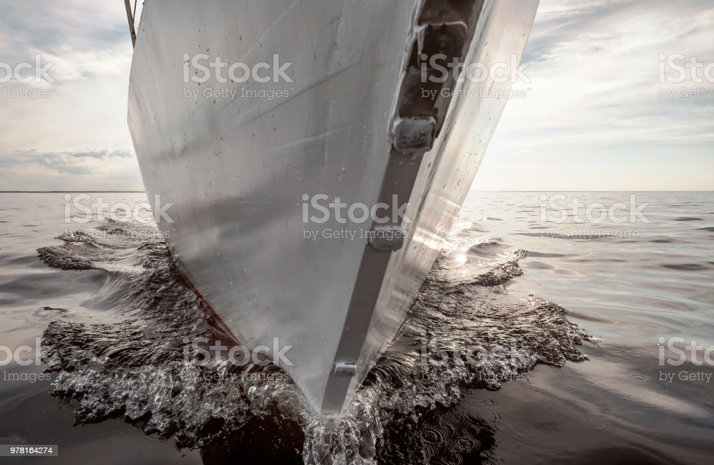 Close up on the bow of a sailing yacht stock photo