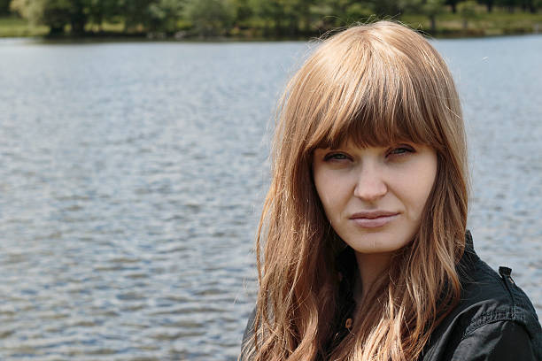 beautiful latvian outdoor girl front view water background - whiteway latvian outdoor girl stock photos and pictures