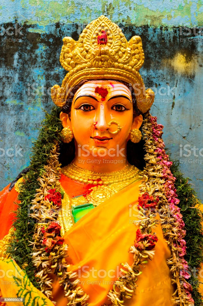 A close up on the face of an idol of Goddess Durga.'nin Tamil nadu they call it as amman. stock photo