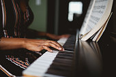 istock close up on the hands of a piano player 1134164388