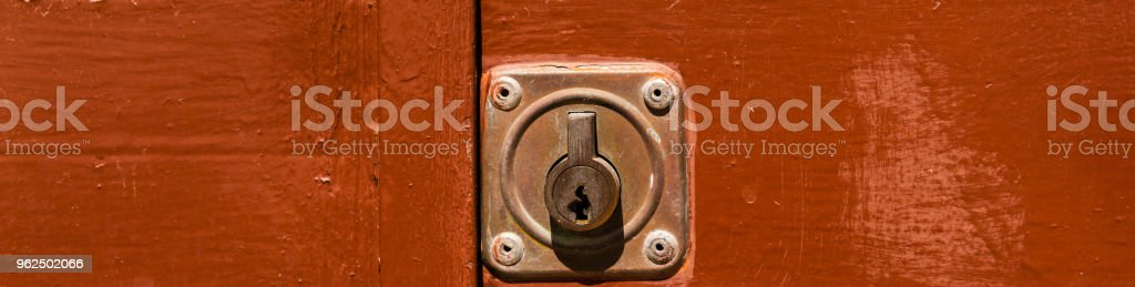 close up on the old lock with an interesting texture on the door, home security - Royalty-free Aging Process Stock Photo