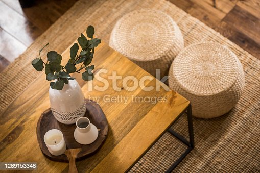 Interior of modern living room with rustic objects.