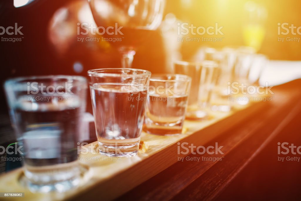 Close up on Vodka shots and other alcohols in a row stock photo