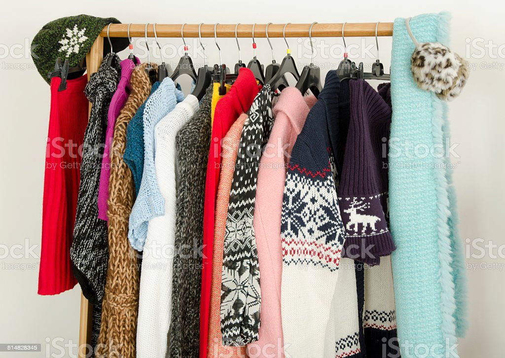 Close up on wardrobe with winter clothes nicely arranged. stock photo