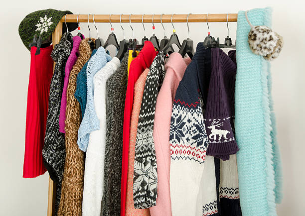 close up on wardrobe with winter clothes nicely arranged. - warm clothing stock photos and pictures
