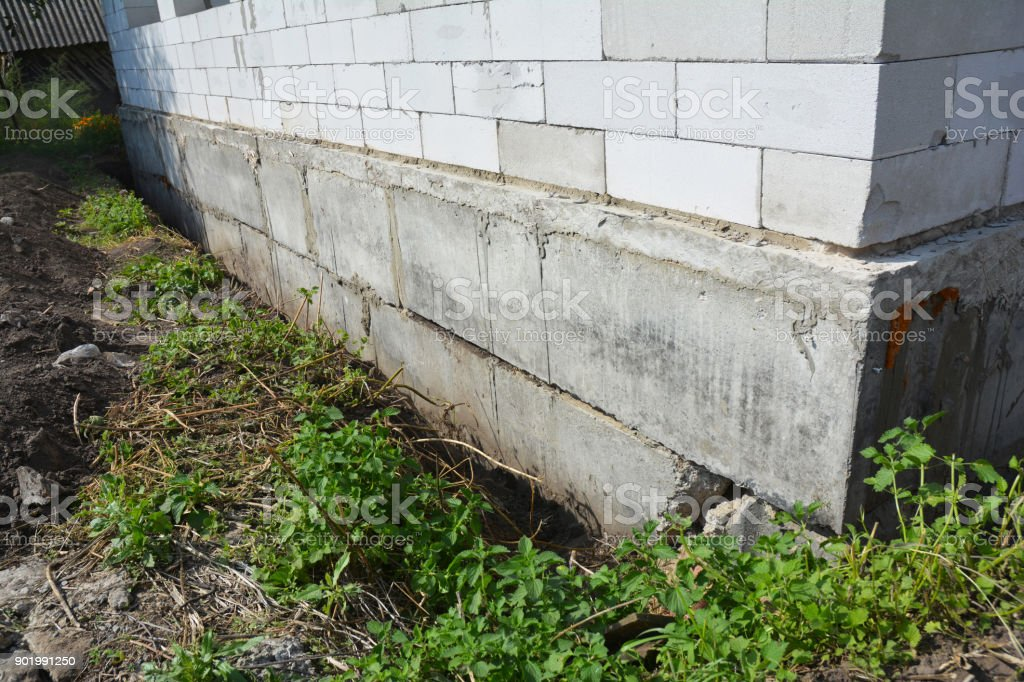 Close up on Waterproofing and insulation house foundation wall. Foundation Waterproofing and Damp proofing Coatings. stock photo