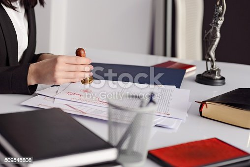 944422446istockphoto Close up on woman notary public hand stamping 509545808
