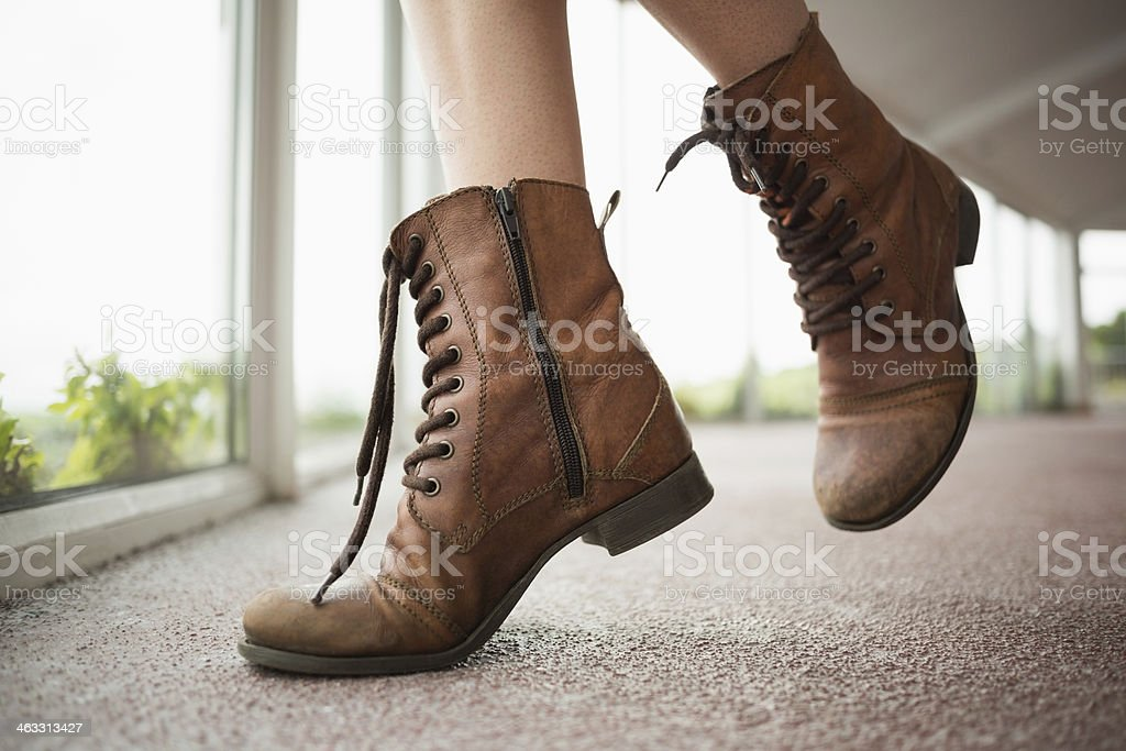 Close up on woman shoes in front of window stock photo