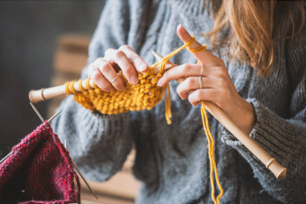 Close up on woman's hands knitting Close up on woman's hands knitting hobbies stock pictures, royalty-free photos & images