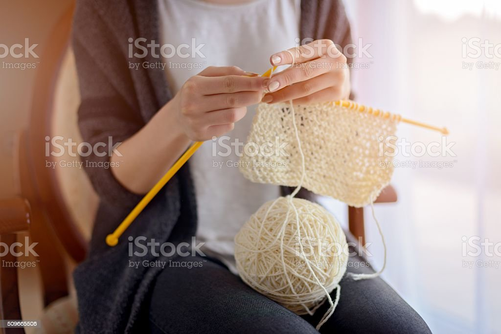 Close up on woman's hands knitting stock photo