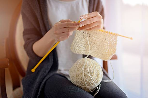 close up on woman's hands knitting - sticka bildbanksfoton och bilder