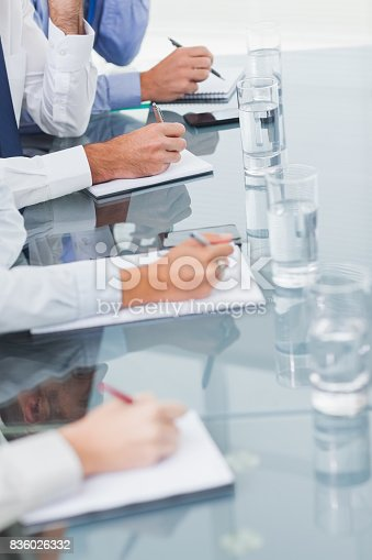 istock Close up on workmates taking notes while attending presentation 836026332