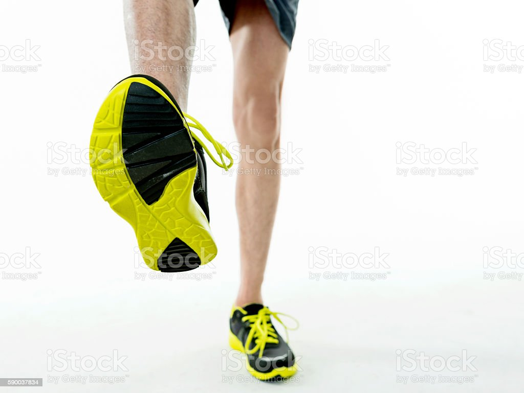 Close up on young man running shoes stock photo