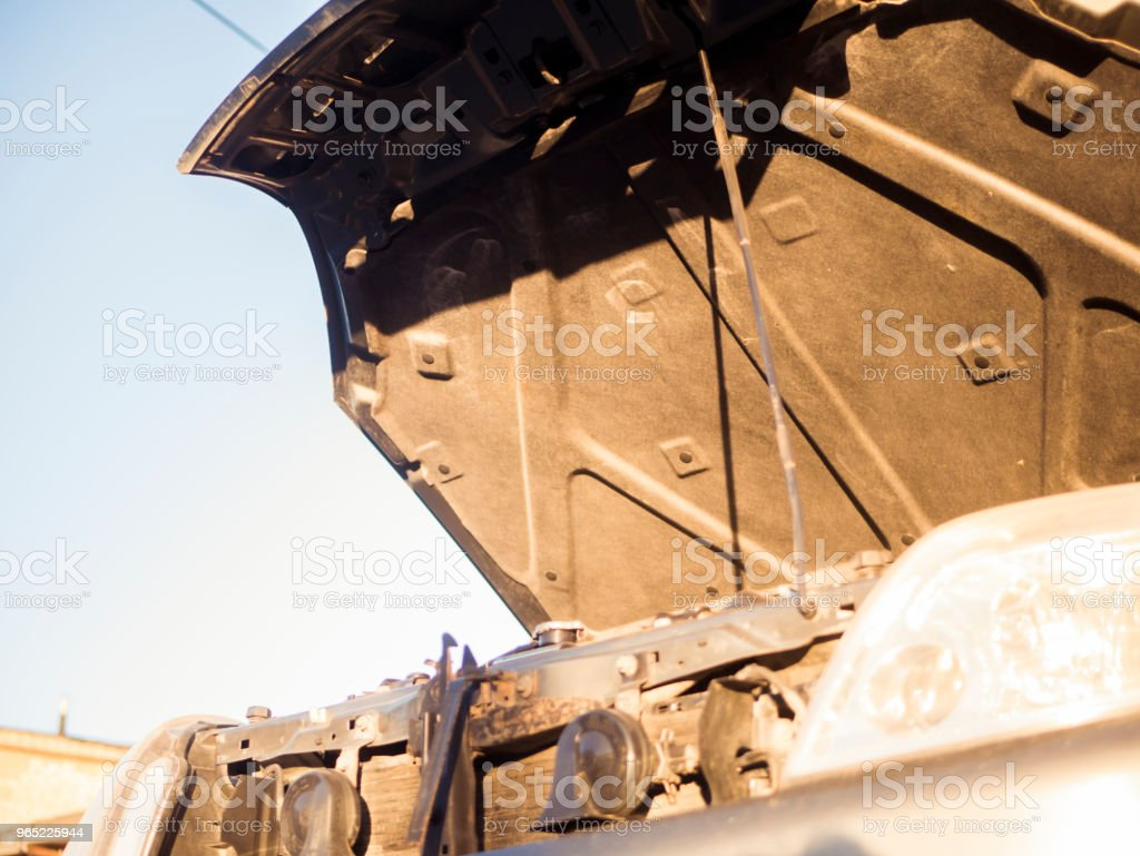 close up opened hood of the car against the sky royalty-free stock photo