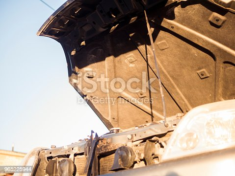 Close Up Opened Hood Of The Car Against The Sky Stock Photo & More Pictures of Adult