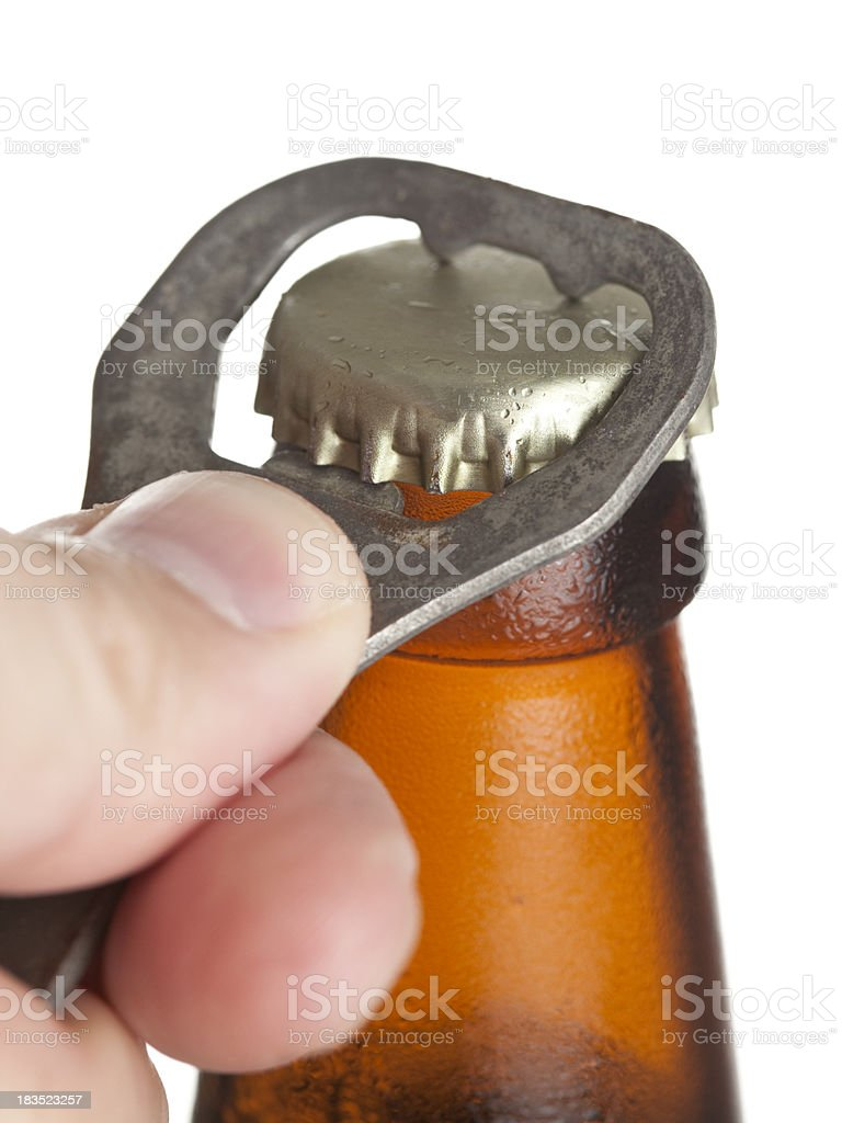 Close up opening a beer bottle on white. stock photo