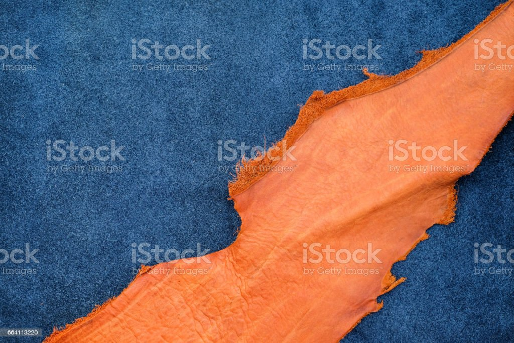 Close up orange rough edge and navy blue leather divide in two section, fashion texture background,fabric division foto stock royalty-free