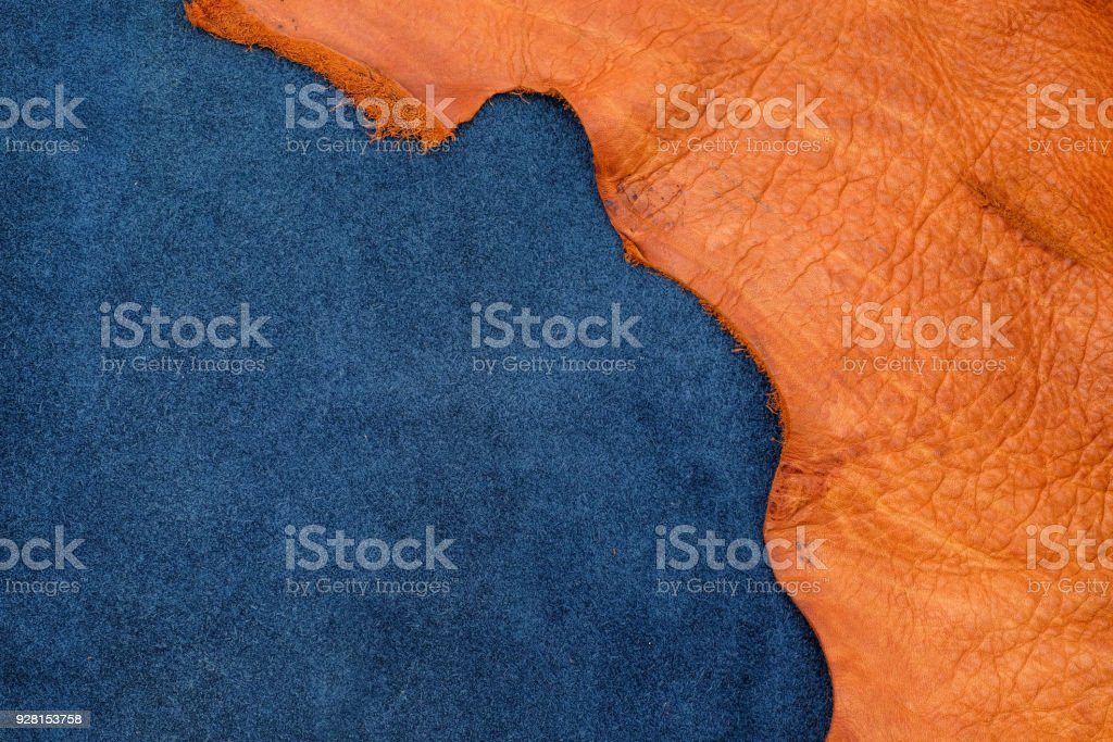 Close up orange rough edge and navy blue leather divide in two section, fashion texture background,fabric division stock photo