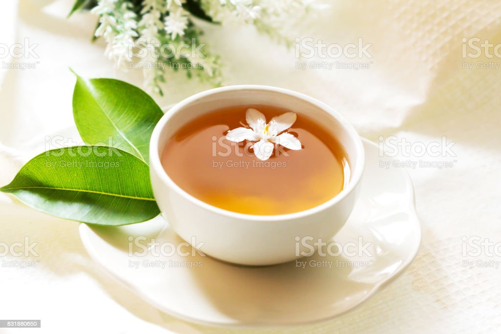 Close up organic tea in white cup with green leaf , Tea ceremony time concept stock photo