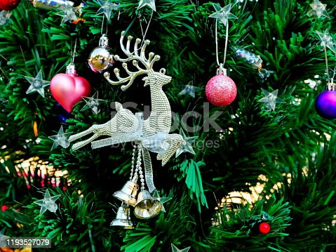 629046810 istock photo Close up outdoor Christmas tree decorated 1193527079