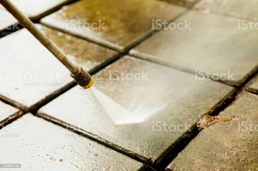 Close up Outdoor floor cleaning with high pressure water jet stock photo