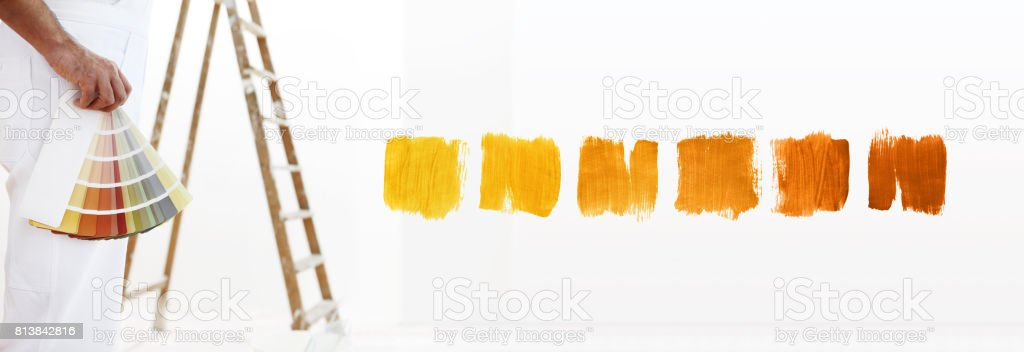 close - up painter man with color swatches in your hand close - up, and color samples on white blank background stock photo