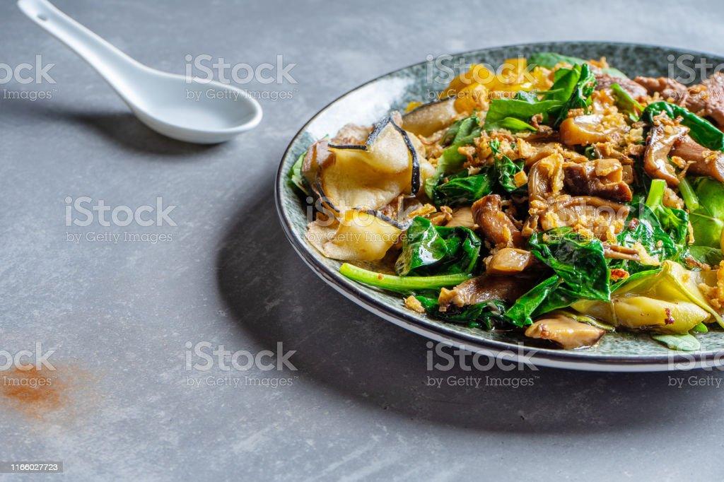 Close up pan-asian thai salad bowl. Flat lay food on grey stone...
