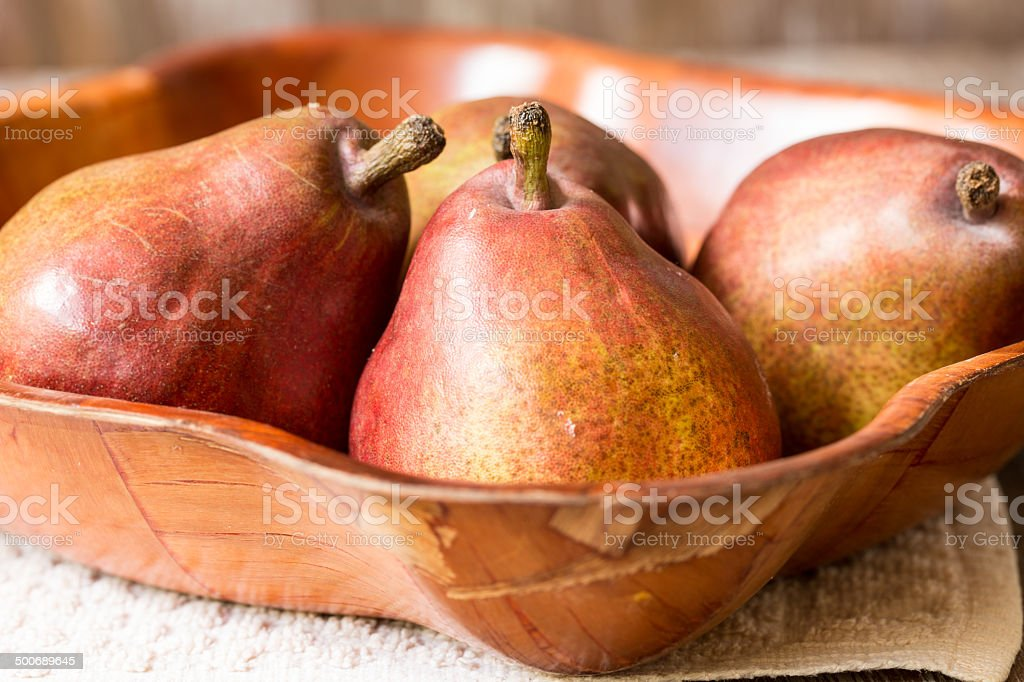 Close Up Pears In Wood Bowl stock photo