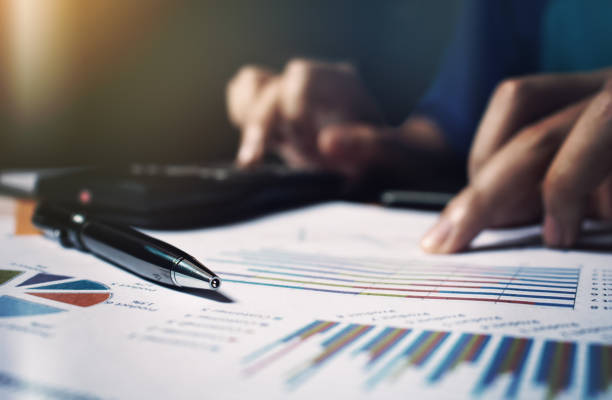 Close up pen on paperwork and woman hand calculate finance. Close up pen on paperwork and woman hand calculate finance. expense stock pictures, royalty-free photos & images