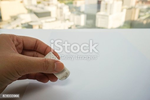 istock close up people hand use eraser on mock up paper sheet for mistake removal 828333966