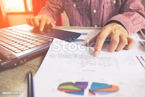 istock Close up people with calculator counting making notes on table, Concept savings finances. 690667276