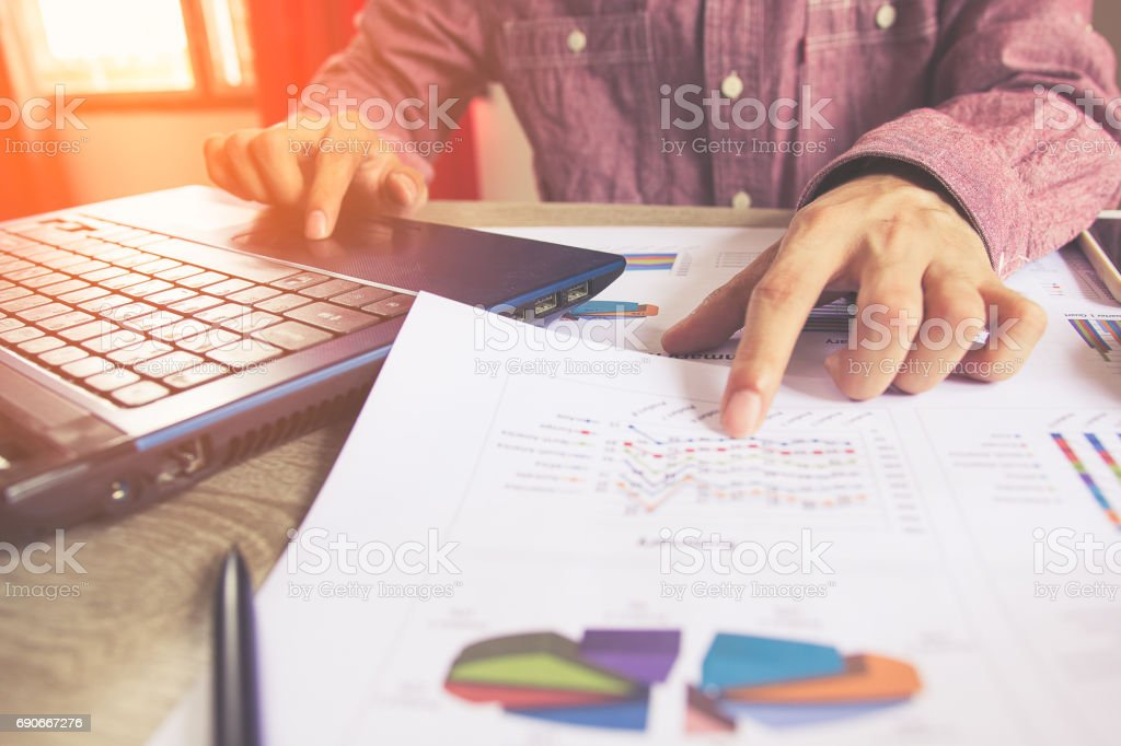 Close up people with calculator counting making notes on table, Concept savings finances. stock photo