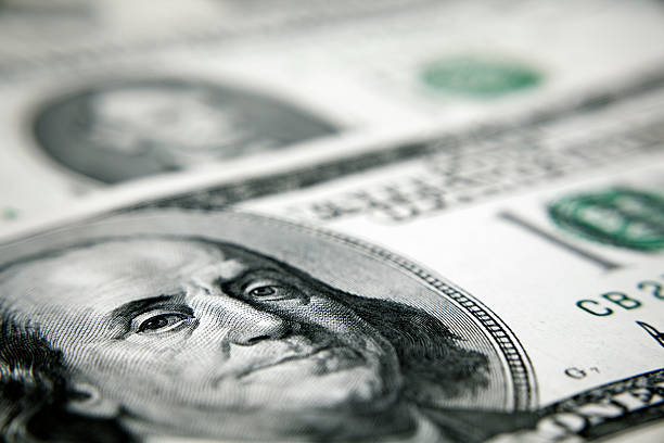 Close up perspective view of hundred-dollar bill One Hundred Dollar Bill US Currency,  benjamin franklin stock pictures, royalty-free photos & images