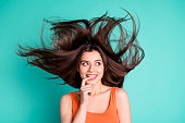istock Close up photo amazing beautiful her she lady weekend vacation wind blowing hair flight healthy condition thoughtful ponder wear casual orange tank-top isolated bright teal turquoise background 1152166486