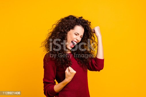 Close up photo amazing beautiful her she lady yelling voice raised fists eyes closed in delight emotional high spirits mood wearing red knitted sweater clothes outfit isolated yellow background