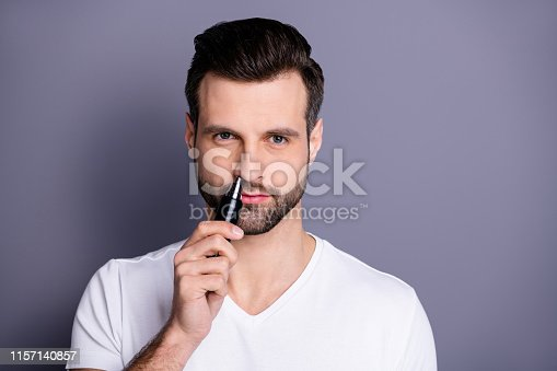 Close up photo amazing he him his macho hairless process buy buyer new hand novelty ready remove nose ear hair with help little comfy trimmer wear, casual white t-shirt isolated grey background