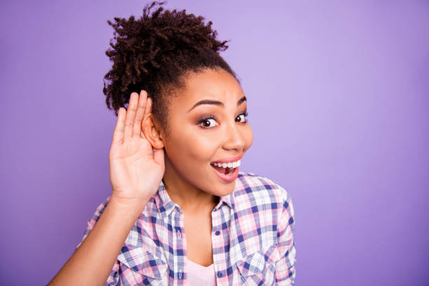 close up photo astonished people youth hear confidential information impressed scandals excited open mouth scream wow omg unbelievable unexpected place hand palm plaid shirt isolated purple background - smile woman open mouth foto e immagini stock