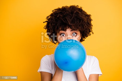 istock Close up photo beautiful amazing she her dark skin lady hold air balloon eyes surprised stupor hiding face big eyes wear casual white t-shirt isolated yellow bright vibrant vivid background 1132775990