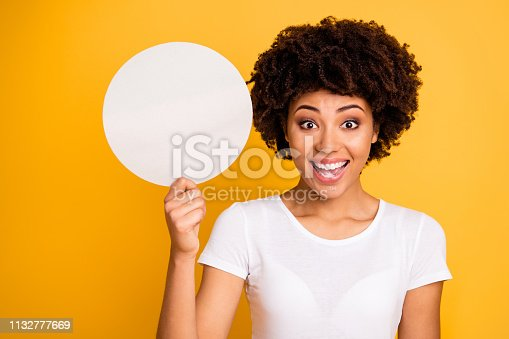 istock Close up photo beautiful amazing she her dark skin lady round circle paper card showing great proposition excited wear casual white t-shirt isolated yellow bright vibrant background 1132777669